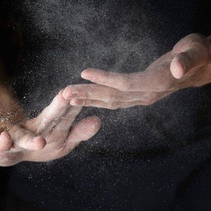 34697846 - adult man hands work with flour